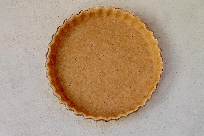 whole grain spelt pastry crust pressed into a pie plate and pricked with a fork