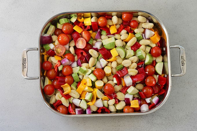 overhead shot of tray of chopped vegetables before cooking