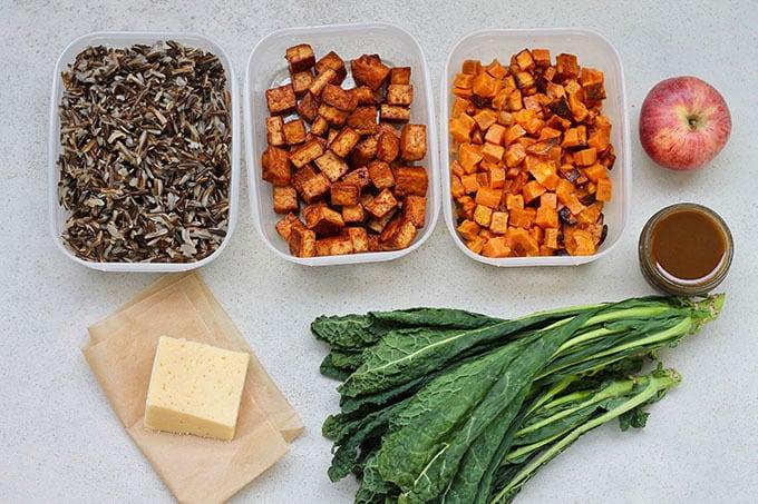 wild rice, sweet potato, tofu, cheese, kale on a grey background
