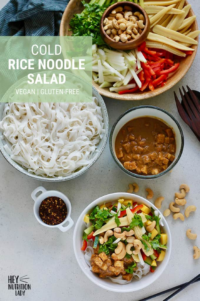 Cold Rice Noodle Salad! This cool and refreshing Asian noodle salad is totally vegan and gluten-free, and has a zippy peanut sauce to complement. You can mix and match the vegetables as you see fit, which makes this healthy recipe family-friendly and versatile as well! #vegan #glutenfree #salad #ricenoodles #asian #vegetarian #healthy #recipe #noodles