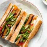tofu banh mi sandwich on a white plate