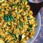 zucchini chickpea quinoa salad in a blue bowl