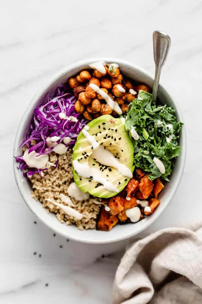 buddha bowl with roasted chickpeas and avocado on top
