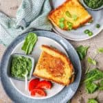 saag paneer grilled cheese on two grey plates