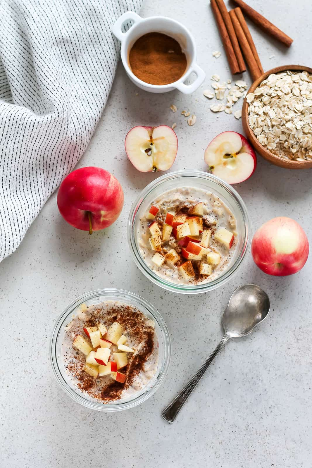 overhead photo of apple cinnamon overnight oats on a grey background