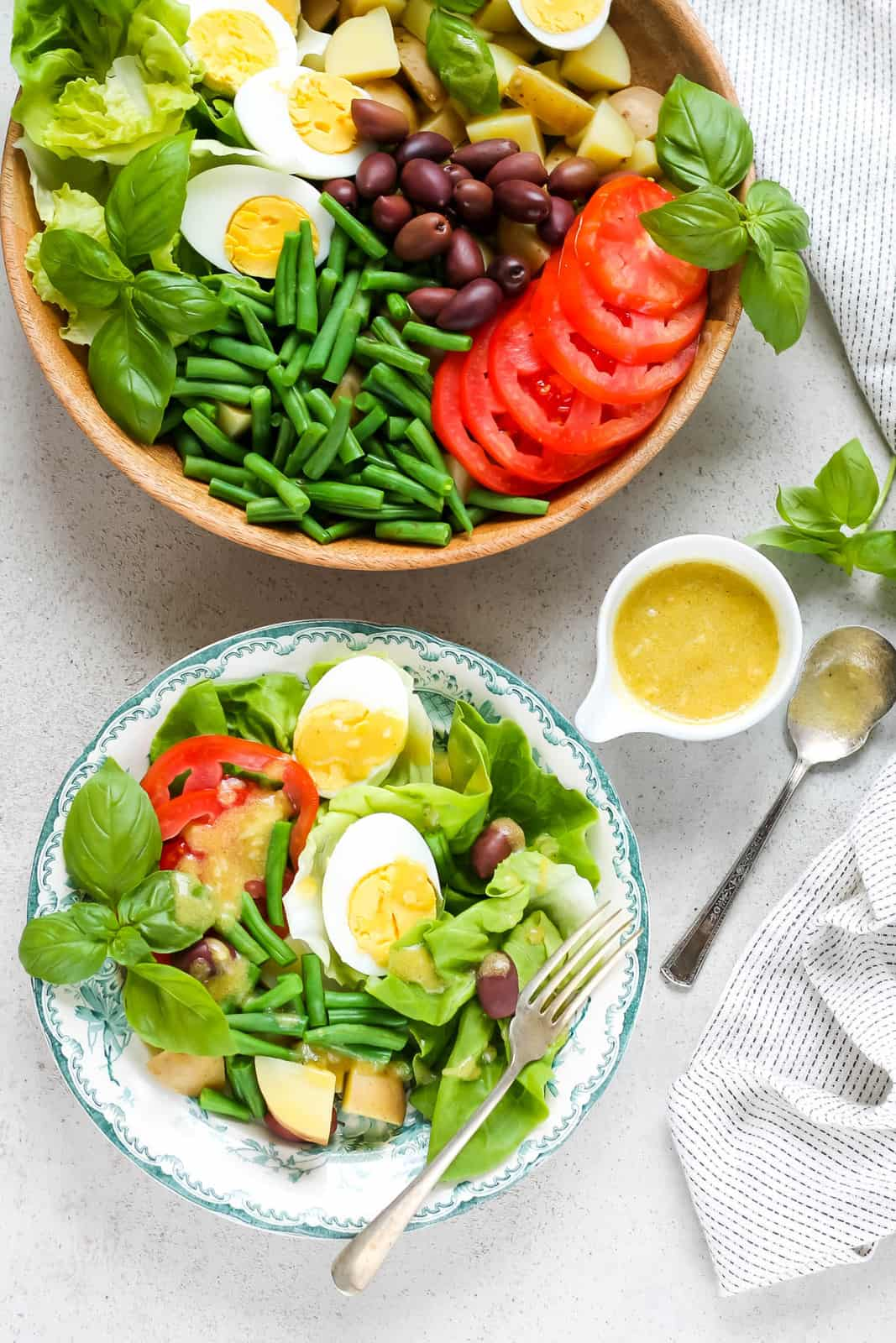overhead photo of a vegetarian nicoise salad on a white and blue plate