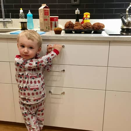 toddler with muffins
