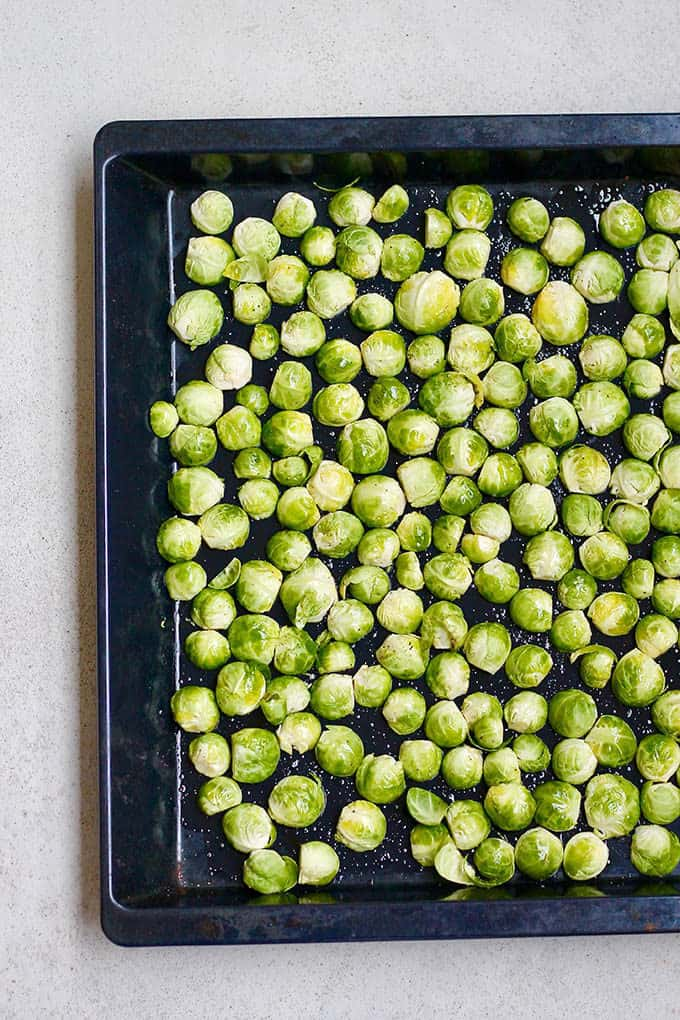 brussels sprouts on a sheet pan about to be roasted