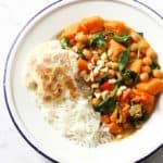 chickpea curry with rice in a white bowl