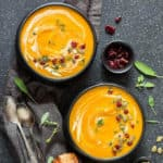 instant pot butternut squash soup in black bowls on a grey background