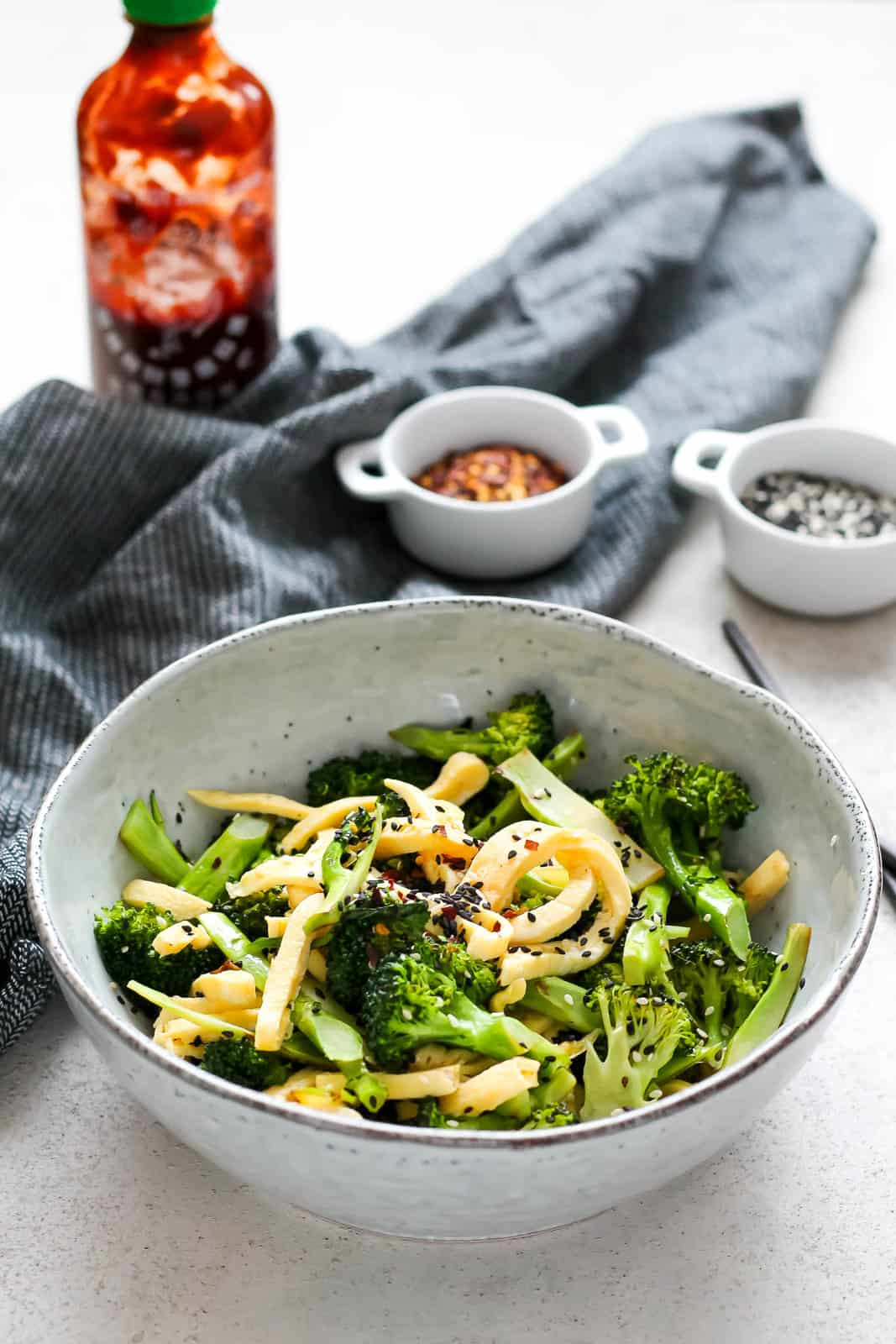 pan-fried broccoli tossed with ribbons of egg in a blue bowl
