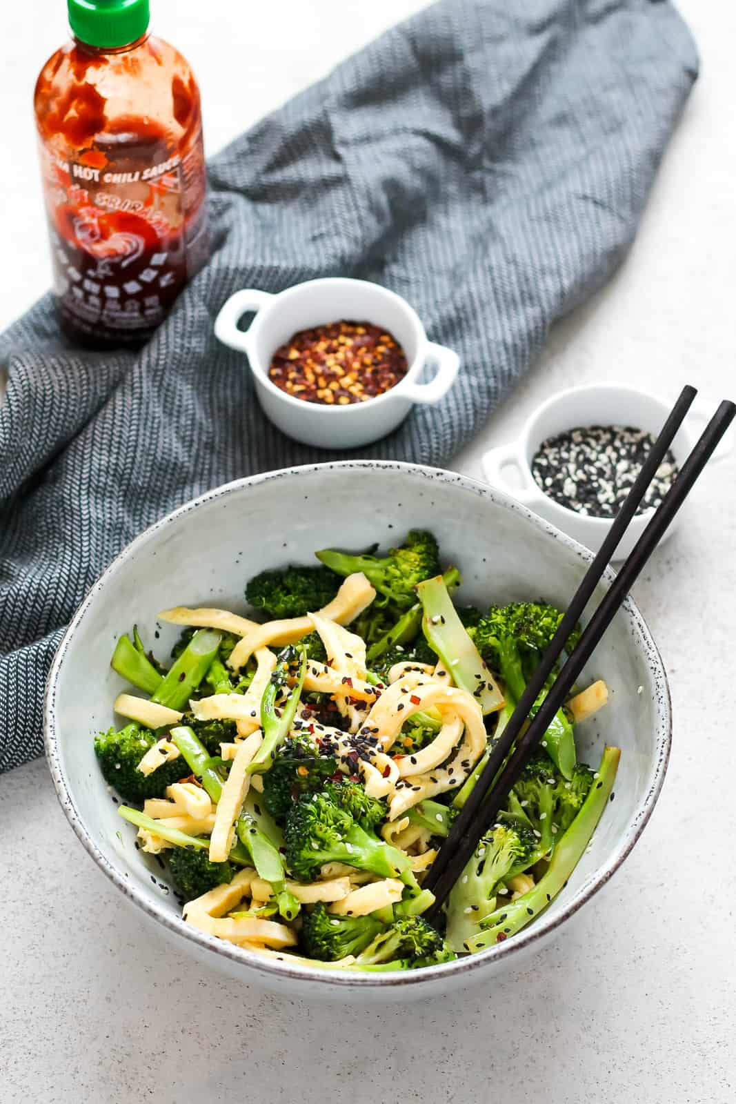 pan-fried broccoli and egg in a blue bowl