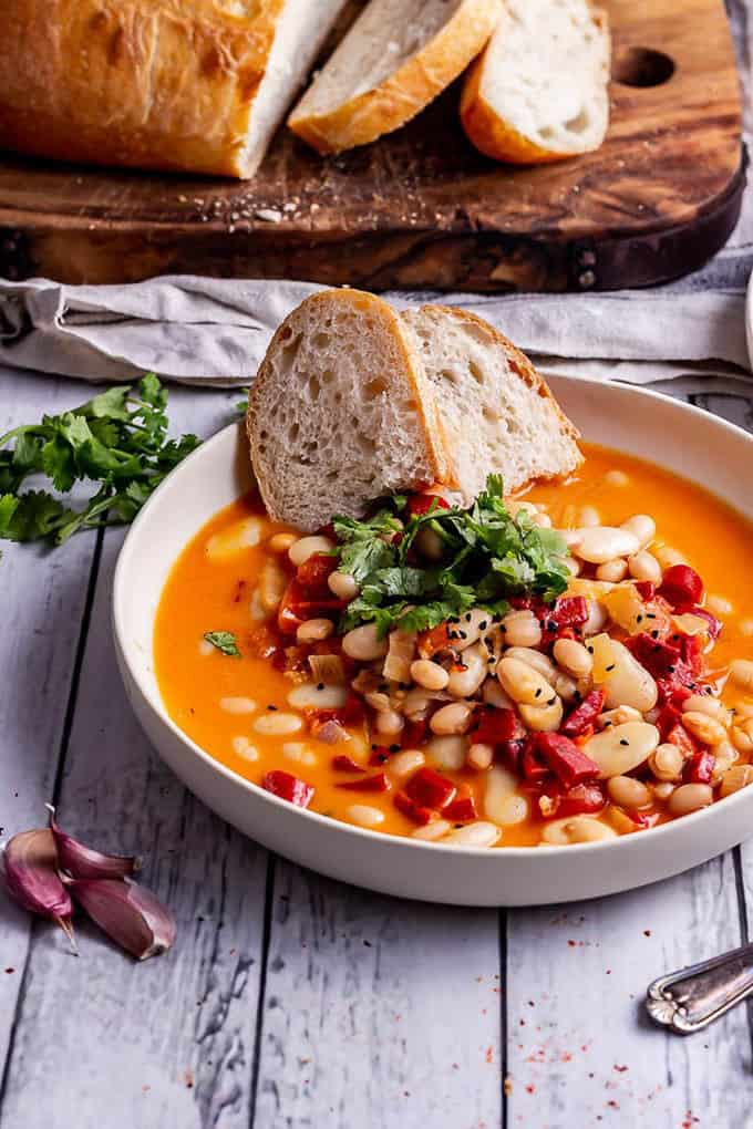 red pepper white bean soup in a white bowl