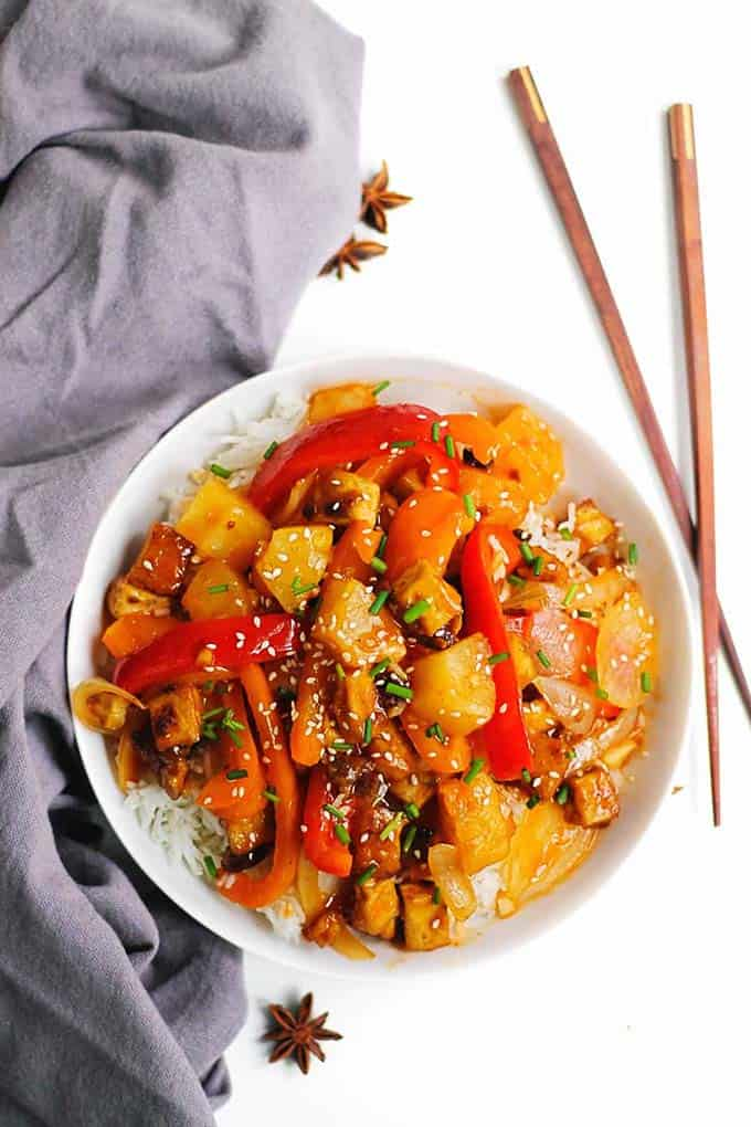 vegan sweet and sour tofu in a white bowl with chopsticks to the side