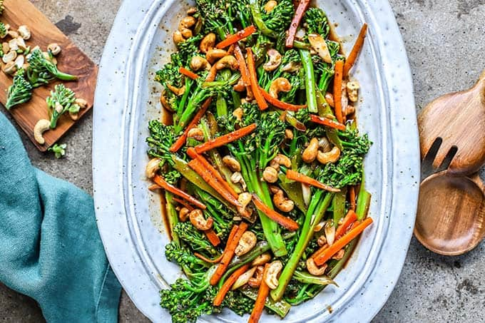 a platter of kung pao broccoli with cashews