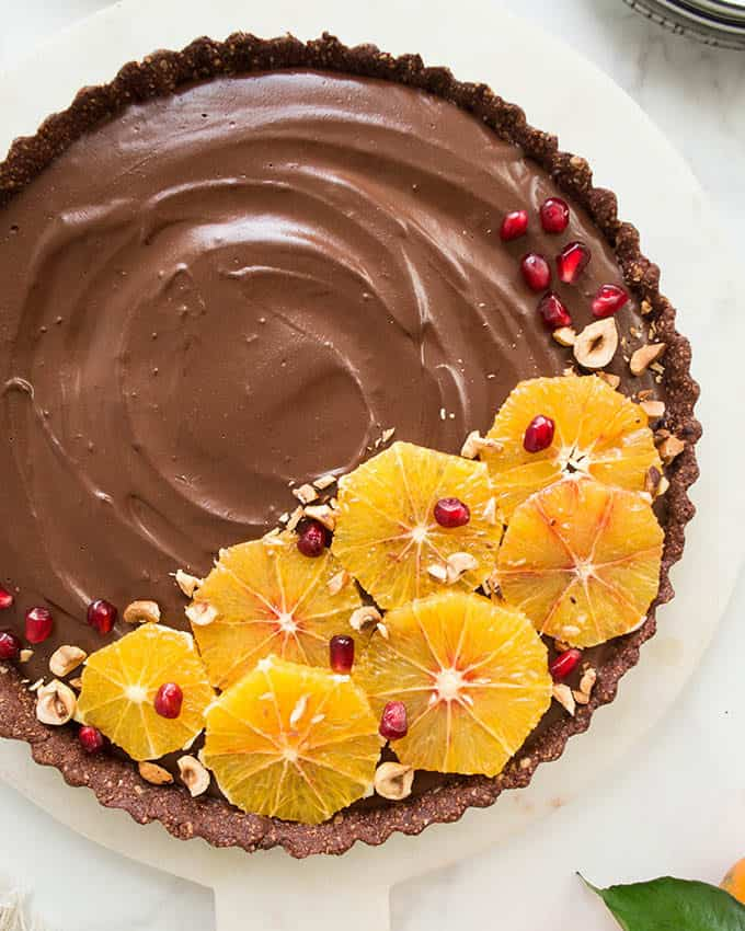 overhead photo of a chocolate tart topped with orange slices