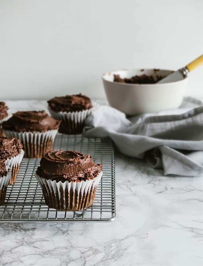 chocolate sweet potato cupcakes on a marble counter top