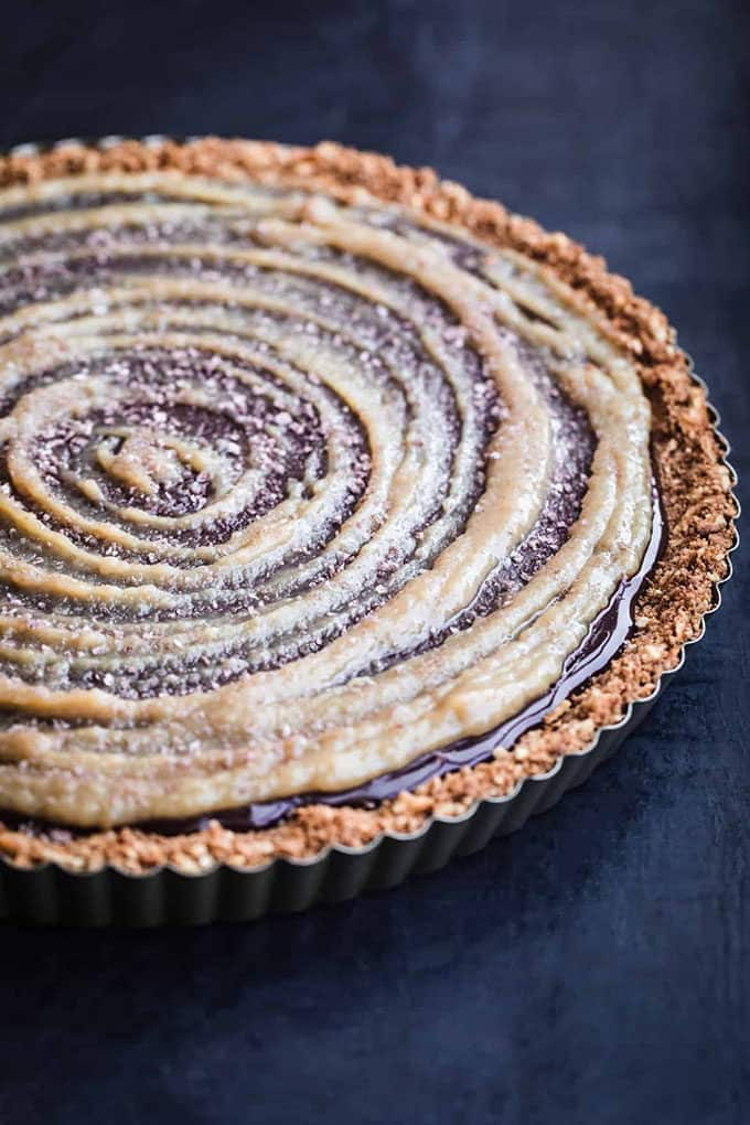 chocolate tahini tart on a dark blue background