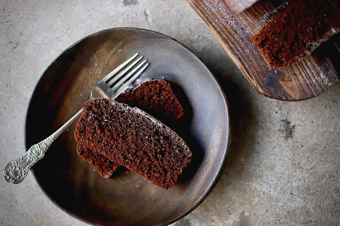 slices of chocolate cake on a wooden plate