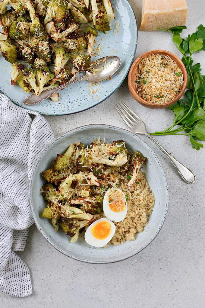roasted romanesco cauliflower with quinoa and a boiled egg in a blue bowl