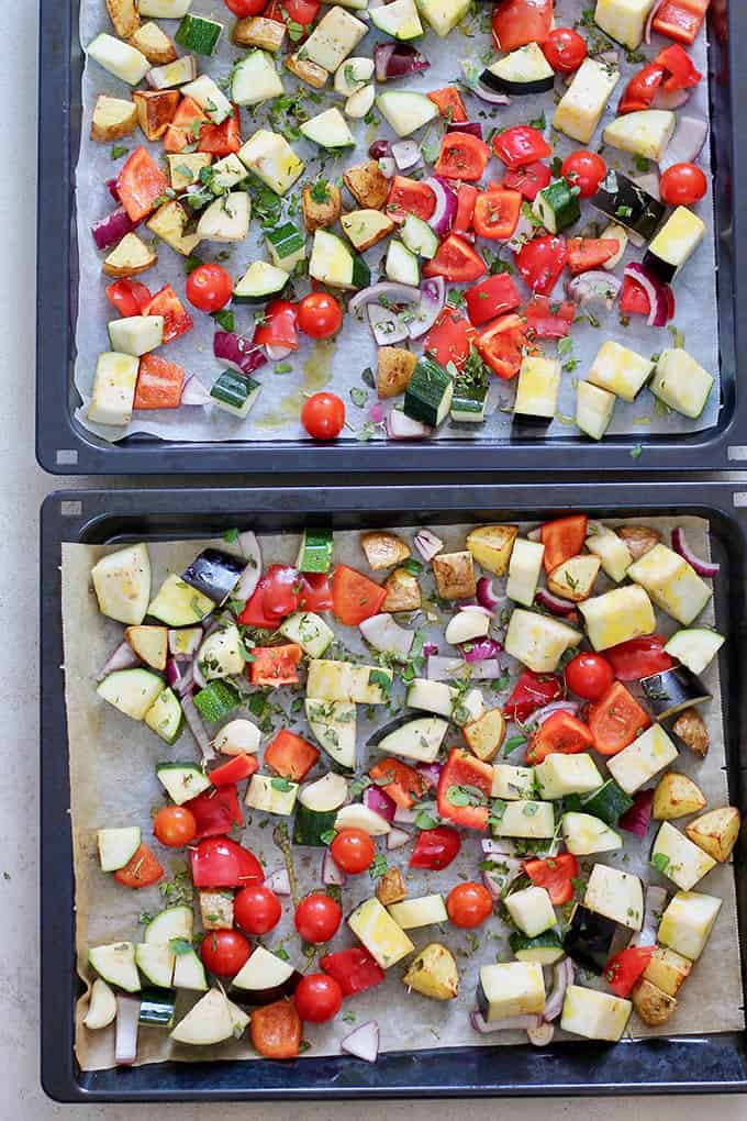 vegetables spread onto two baking sheets