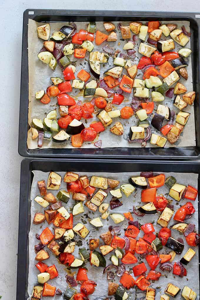 two trays of roasted vegetables