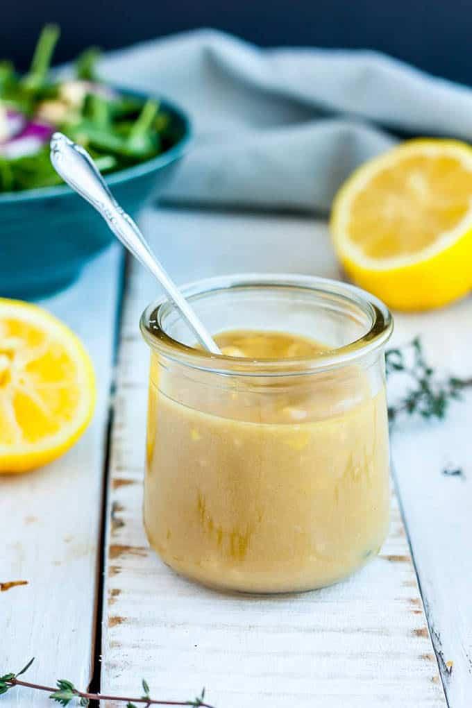 lemon tahini salad dressing in a glass jar