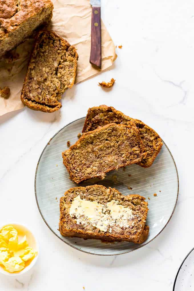 low fodmap banana bread sliced on a blue plate