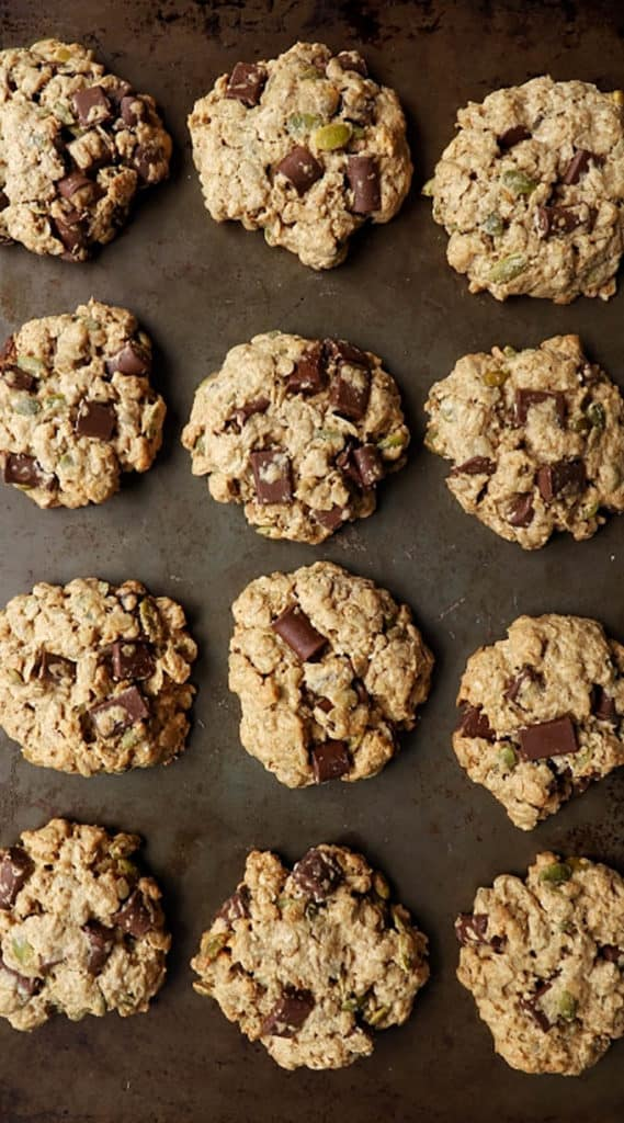 trail mix cookies on a metal baking sheet