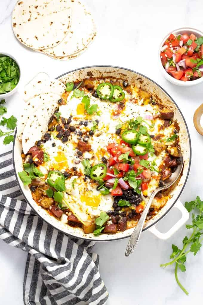 mexican breakfast casserole in a white casserole dish