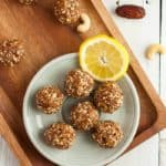 lemon bliss balls on a wooden tray