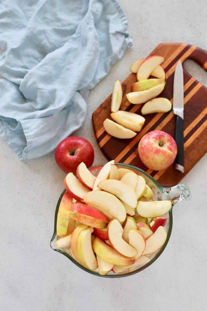 sliced apples in a pyrex bowl