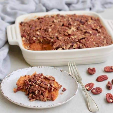 vegan sweet potato casserole on a white plate
