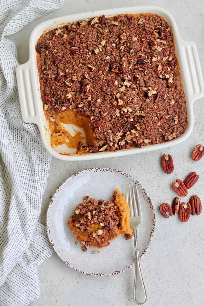 overhead photo of vegan sweet potato casserole on a grey background