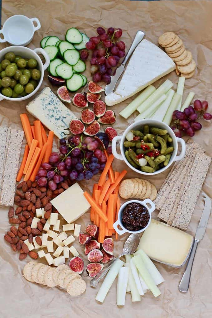 vegetarian cheese board on a sheet of brown paper