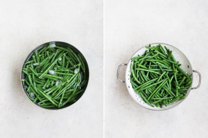 blanched green beans in a white colander