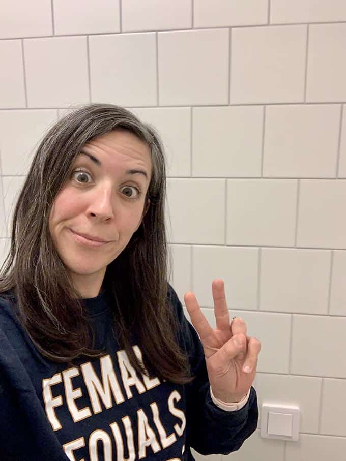 a woman with brown hair wearing a shirt that says female equals future