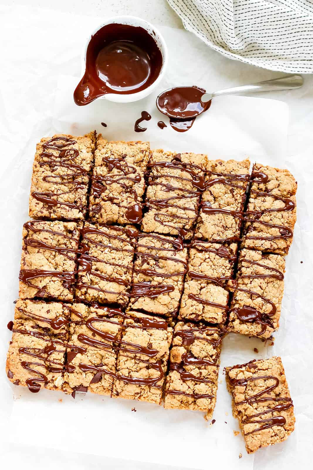 overhead photo of peanut butter oat bars drizzled with dark chocolate