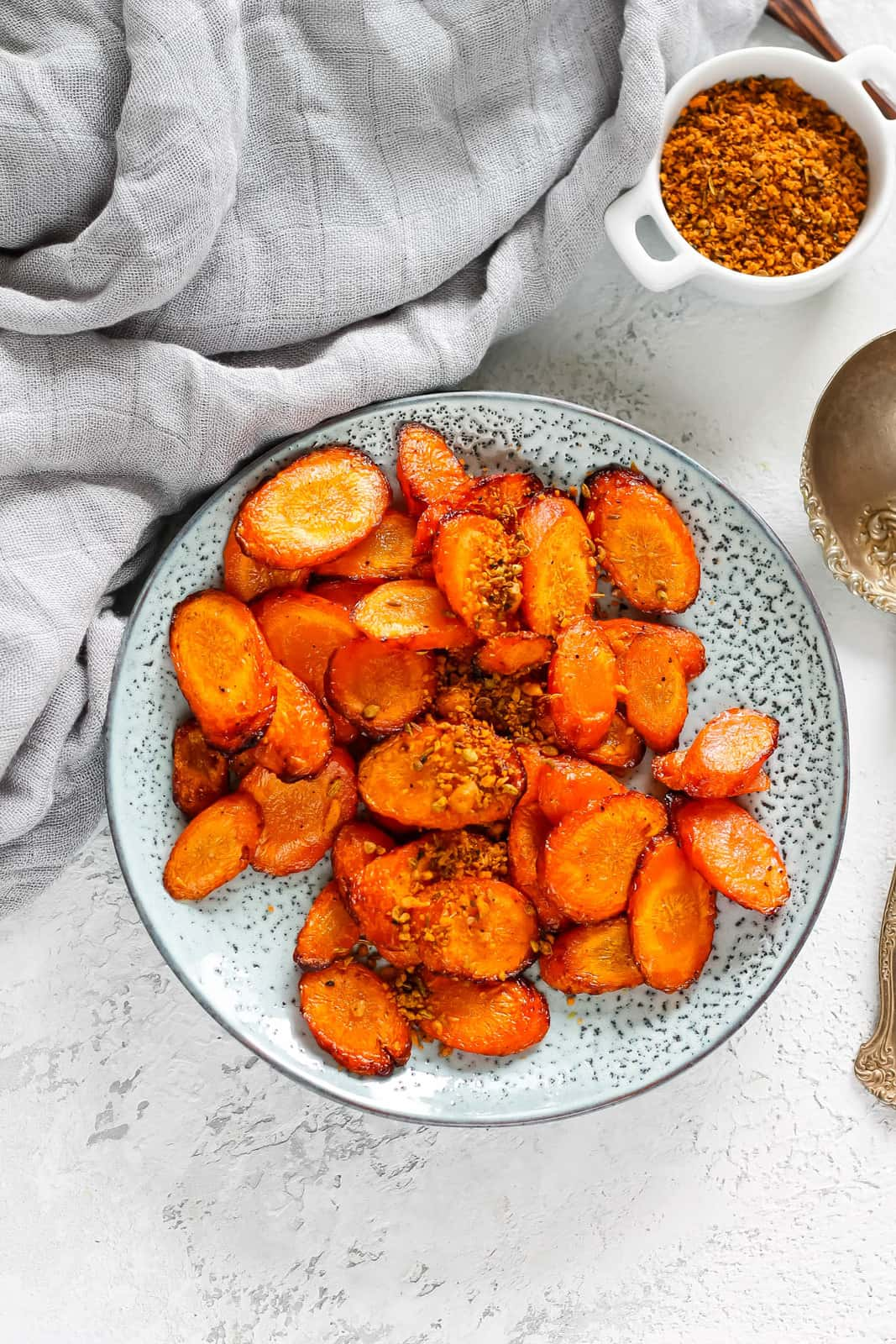 overhead photo of air fryer roasted carrots on a blue plate