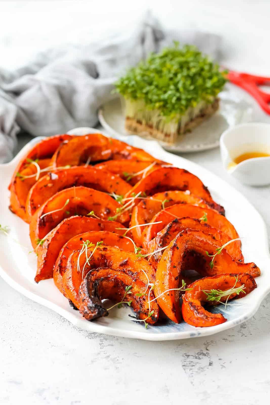 roasted hokkaido pumpkin wedges on a blue and white platter