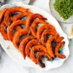 hokkaido pumpkin slices on a white platter