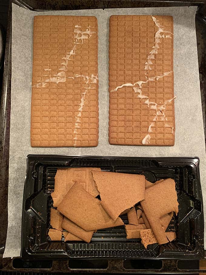 photo of broken gingerbread house pieces on a tray