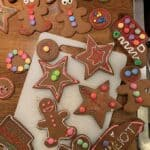 a bunch of decorated gingerbread cookies on a wooden counter top