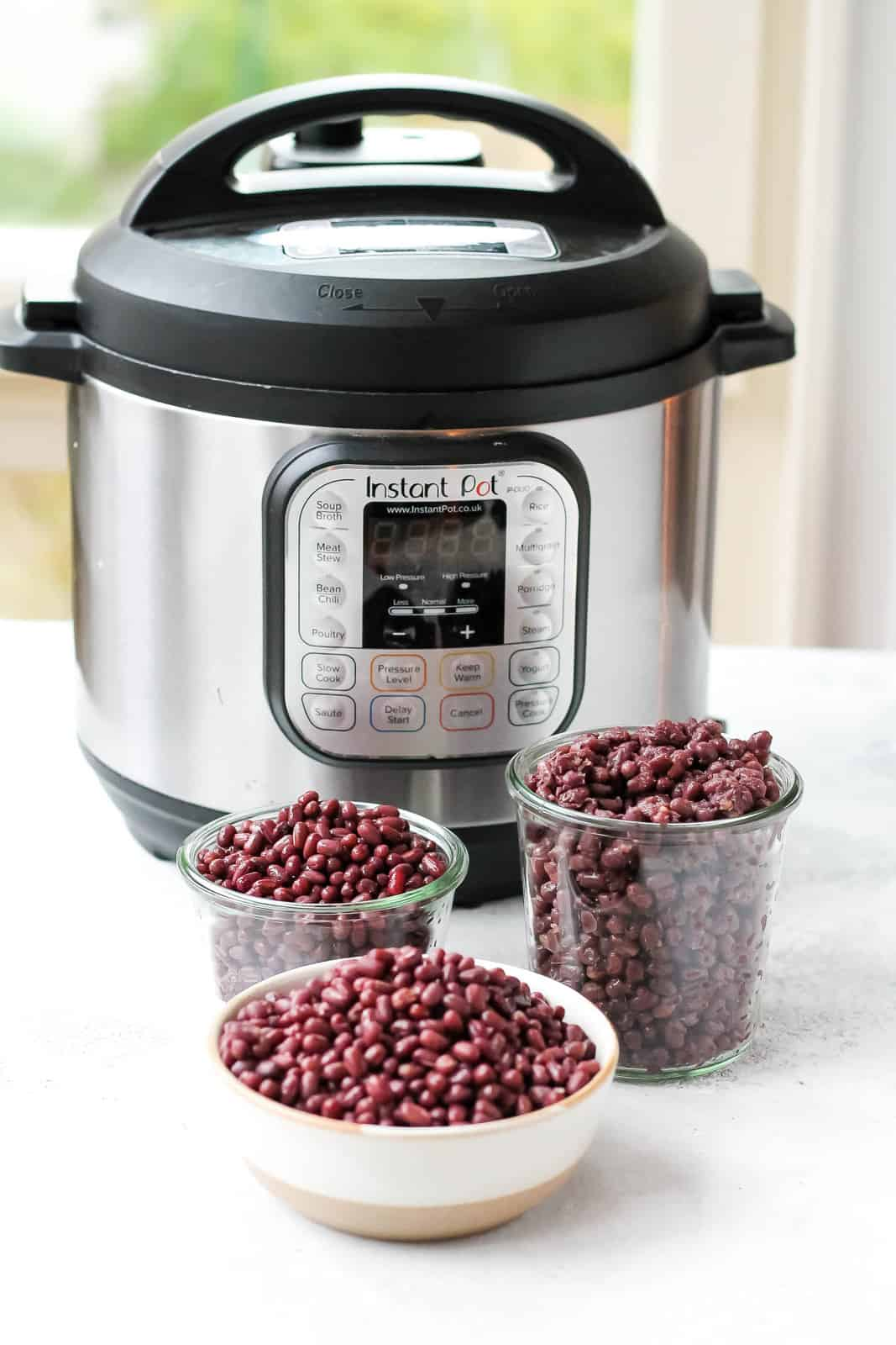 three bowls of adzuki beans in front of an instant pot