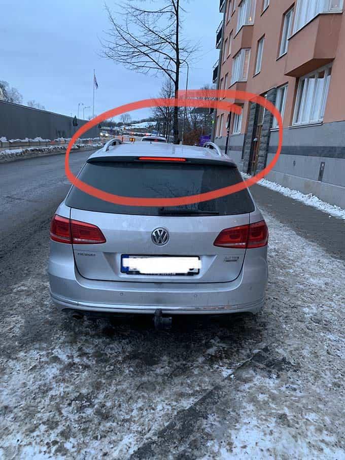 a silver volkswagen passat parked on a snowy street