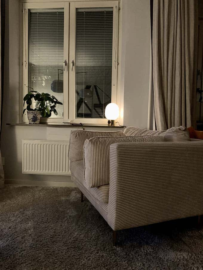 a white armchair with a reading lamp next to it