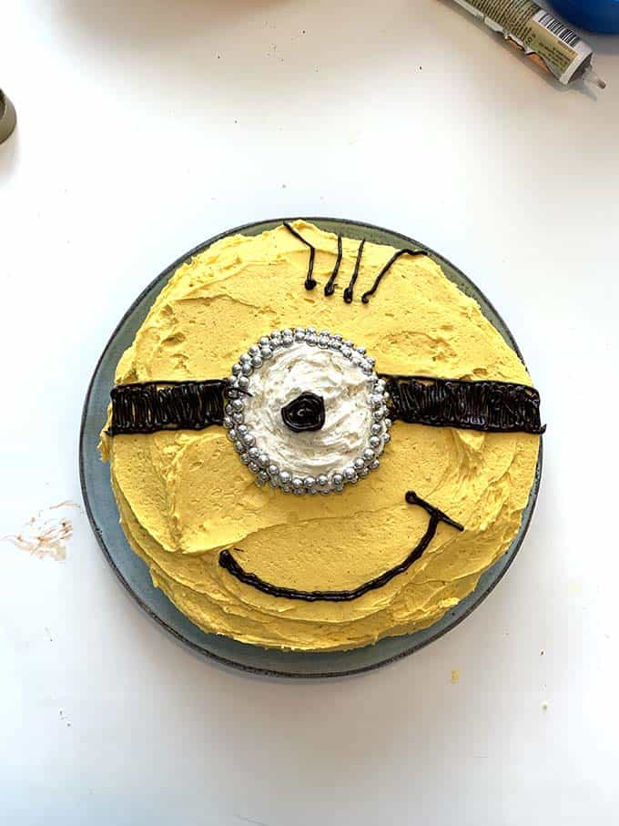 a yellow cake decorated as a minion