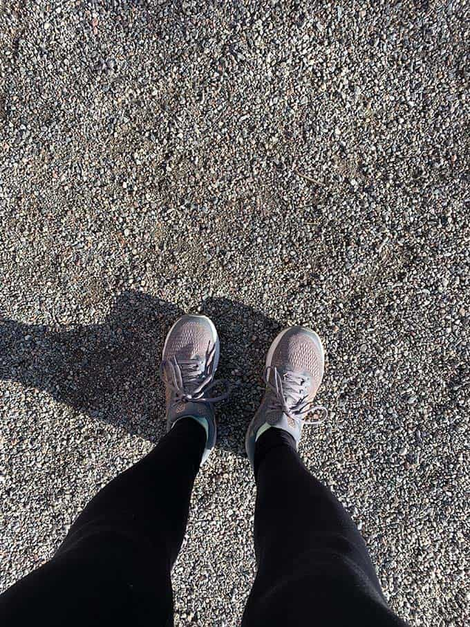 a woman's feet in running shoes