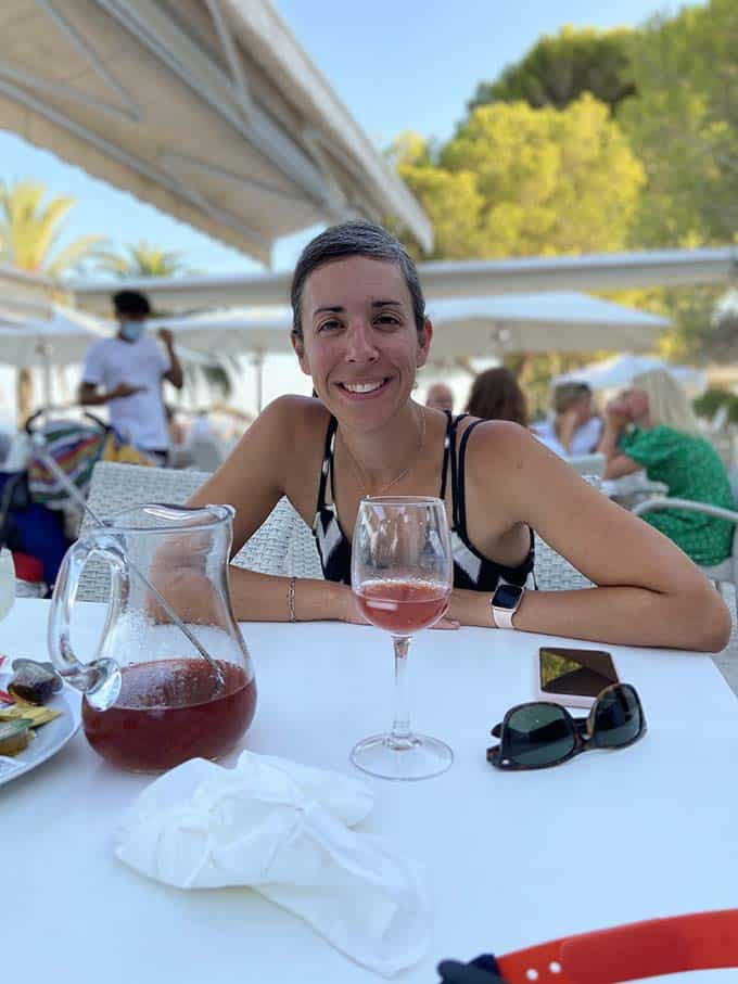 a lady drinking sangria at a restaurant table