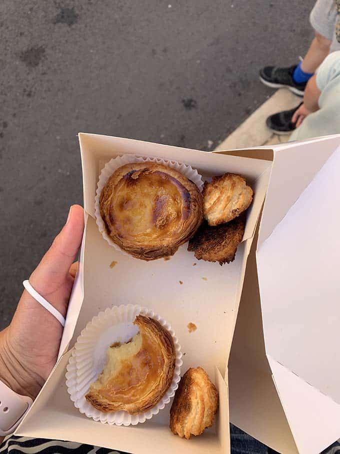 a box of portuguese custard tarts